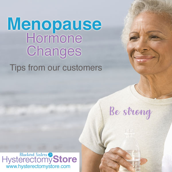 Woman in menopause walking on beach